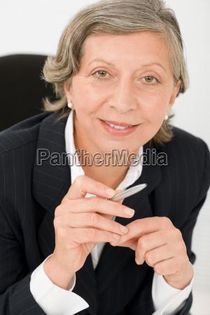 senior businesswoman professional hold pen