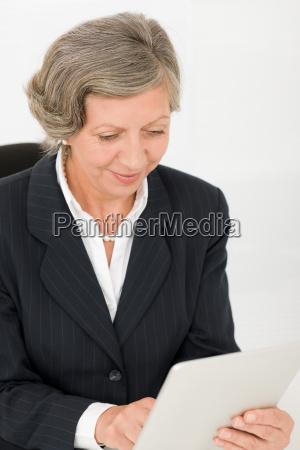 senior businesswoman touch screen tablet computer