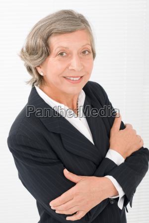 senior businesswoman crossed arms portrait smart