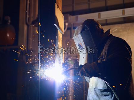 man, at, work, as, welder, in - 5809439
