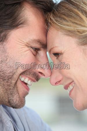 closeup of a loving couple touching