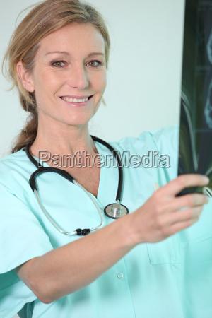 nurse holding radiography
