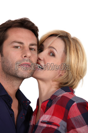 a woman playfully biting the ear