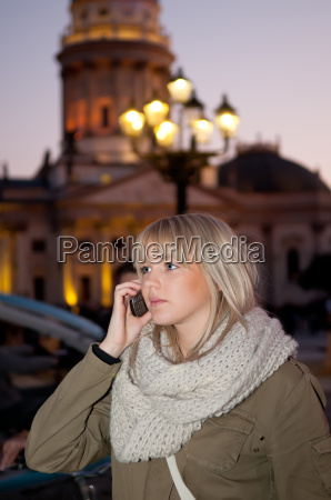 young woman phoning in the city