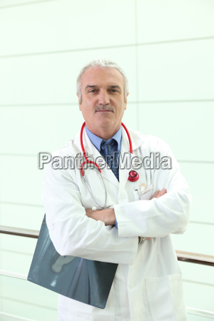 mature doctor crossing arms