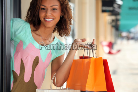 woman leaving store with shopping bags