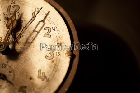 old clock shows 5 before 12