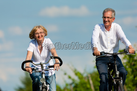 happy couple rides a bike in