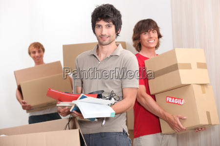 house mates carrying boxes