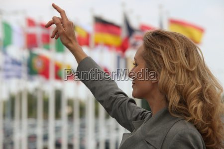woman hailing a taxi in front