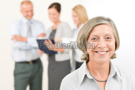business team senior woman with happy