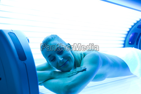 woman in solarium on the sunbed