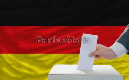 man voting on elections in germany