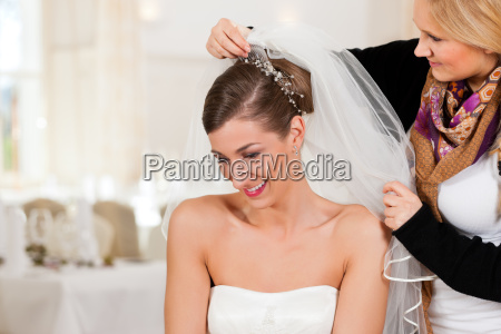 hairdresser puts a brides hairstyle