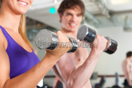 sport couple is exercising with