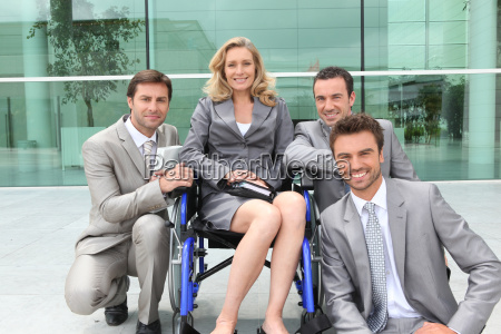 female executive in wheelchair with colleagues