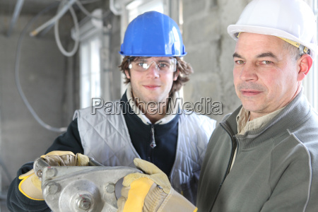 construction worker and young helper
