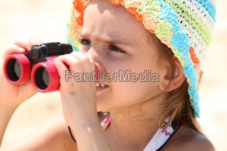 little girl on the beach with