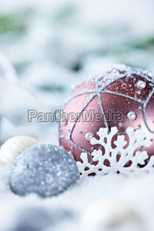 christmas balls and gift in snow