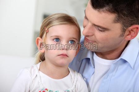 man staring lovingly at his daughter