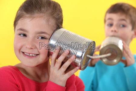 kids using tin cans to communicate