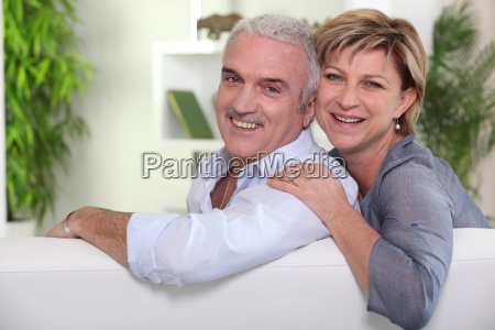 mature couple sitting on the sofa