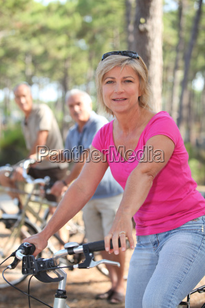 woman riding a bike with friends