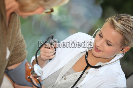 doctor measuring the blood pressure of