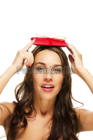 beautiful woman holding gift on her