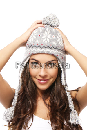 beautiful woman with winter cap holding