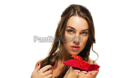 beautiful woman showing red gift