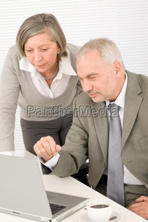 senior businesspeople professional look computer
