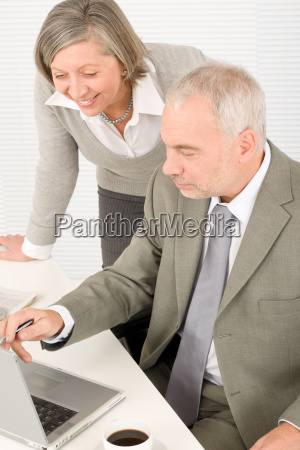 senior businesspeople in office work on