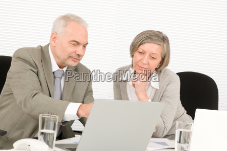 senior businesspeople working computer in office