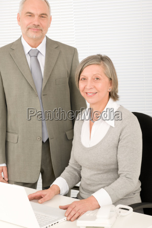 senior happy businesspeople working on computer