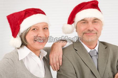 christmas hat senior businesspeople fun laughing