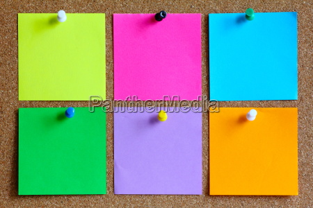 colorful sticky notes on cork bulletin