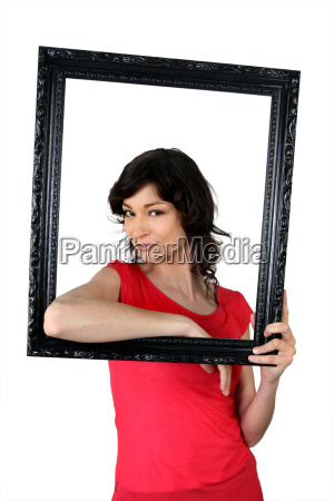 woman holding herself within a picture