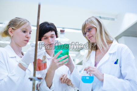 three female researchers carrying out research