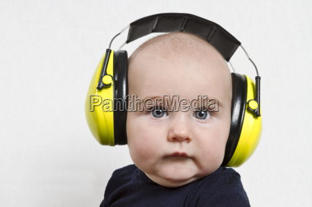 baby with ear protection