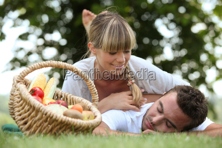 couple lying on the grass