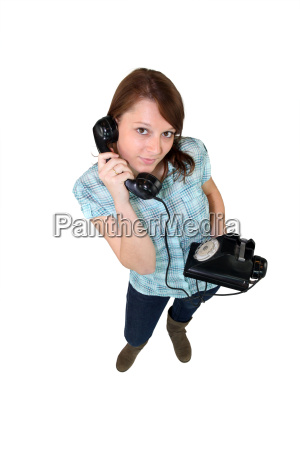 young woman with a retro phone