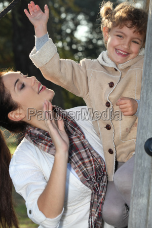 mother, and, daughter, climbing, a, tree - 5922209