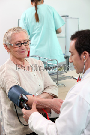 doctor taking his patient039s blood pressure