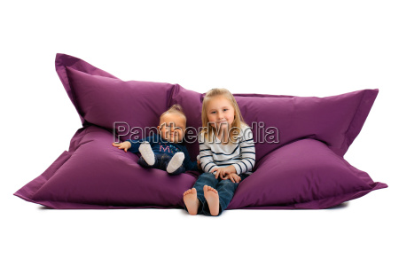 two sister sitting on beanbag