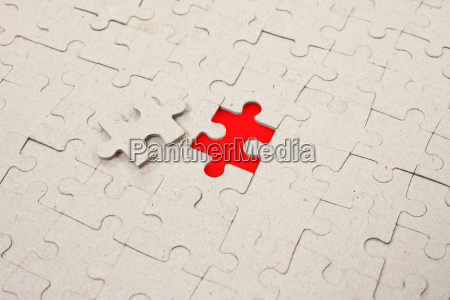 papper puzzle with red piece