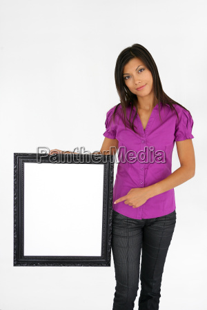 woman pointing at a picture frame