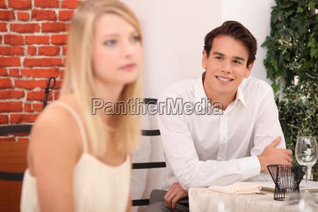 man admiring blond woman in restaurant