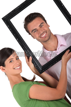 couple with a picture frame