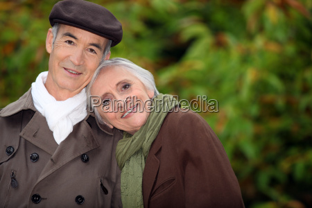 a mature couple in a park
